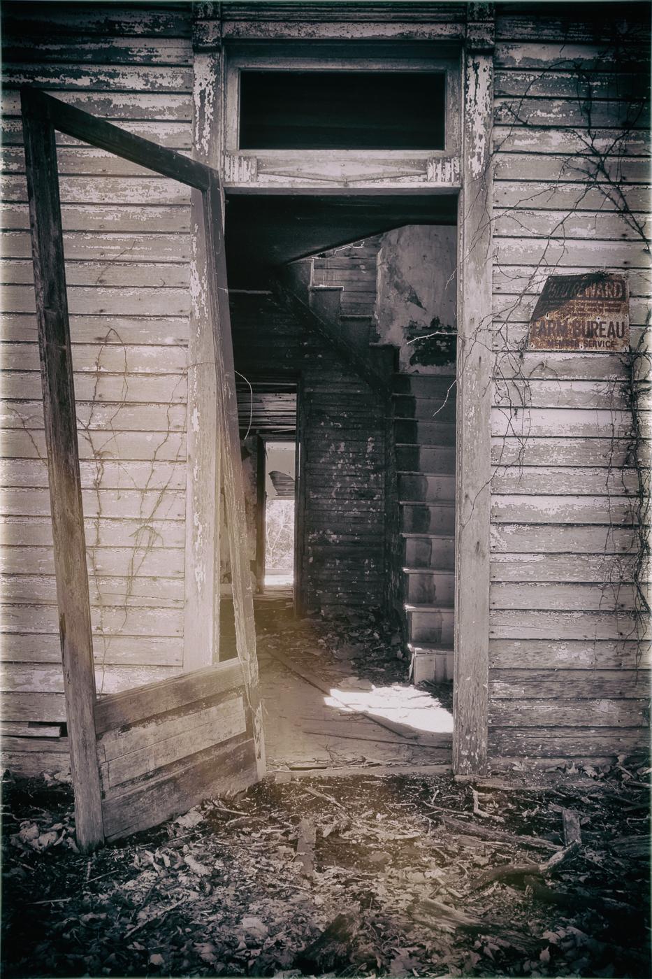 An aged door swung open