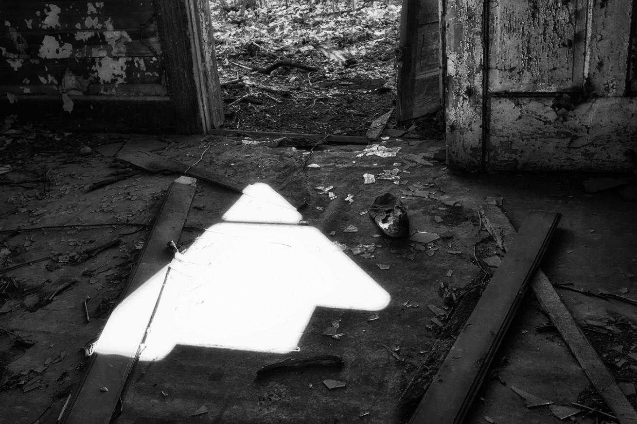 Child's Shoe on Broken Glass