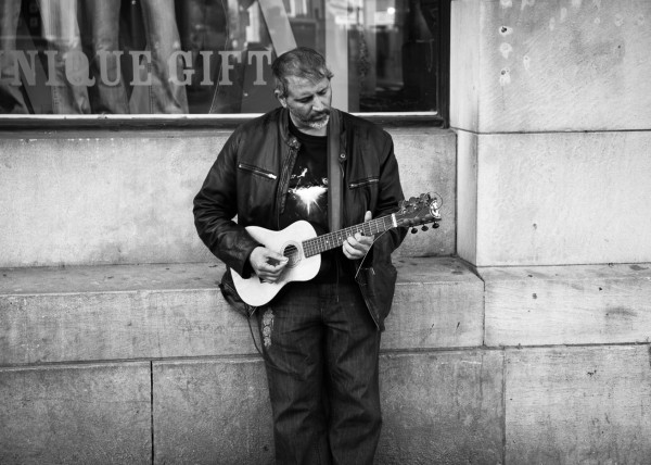 Man with Guitar on Street